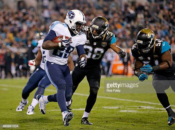 Leon Washington of the Tennessee Titans carries as Tommie Campbell and Jeremiah George of the Jacksonville Jaguars defend during the game at EverBank...