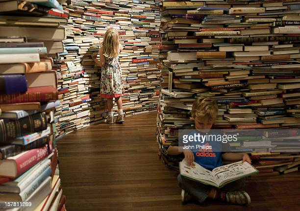 Leona And Charlie Ryan Of Norfolk Play In A Labyrinth Of 250,000 Books, Entitled Amazeme Is Installed On The Clore Ballroom In The Royal Festival...