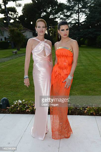 Leona Koenig and Eva Dichandattend the 2012 amfAR's Cinema Against AIDS during the 65th Annual Cannes Film Festival at Hotel Du Cap on May 24 2012 in...