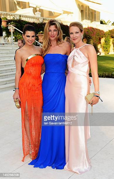 Leona Koenig Nicole Junkermann and Eva Dichand attend the 2012 amfAR's Cinema Against AIDS during the 65th Annual Cannes Film Festival at Hotel Du...