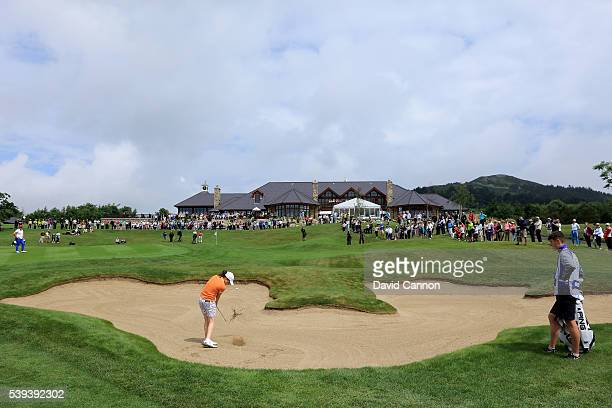 Leona Maguire of Ireland and the Great Britain and Ireland Team plays her third shot from the edge of the bunker short of the 18th green in her match...