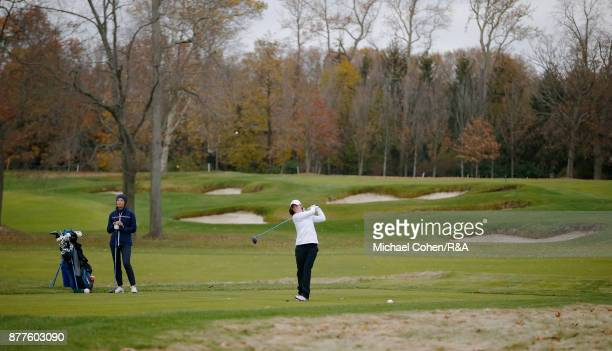 Leona Maguire of team GBI hits a drive as Sophie Lamb looks on during Curtis Cup practice at Quaker Ridge GC on November 22 2017 in Scarsdale New York