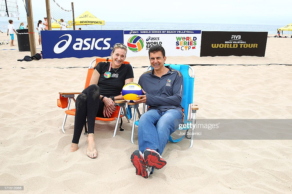 Leonard Armato, CEO and Three-time gold medalist Kerri Walsh Jennings rpose for a photo at the ASICS World Series of Beach Volleyball on June 25, 2013 in Manhattan Beach, California