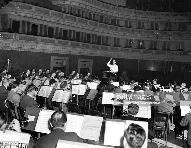 Leonard Bernstein 25 years old conducts a rehearsal for his first symphony Jeremiah with the Philharmonic Symphony Orchestra in Carnegie It will be...