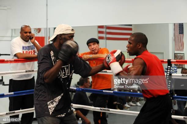 Leonard Ellerbe, trainer Roger Mayweather, Raphael Garcia and boxer Floyd Mayweather trains at Las Vegas Boxing Gym on June 11, 2009 in Las Vegas,...