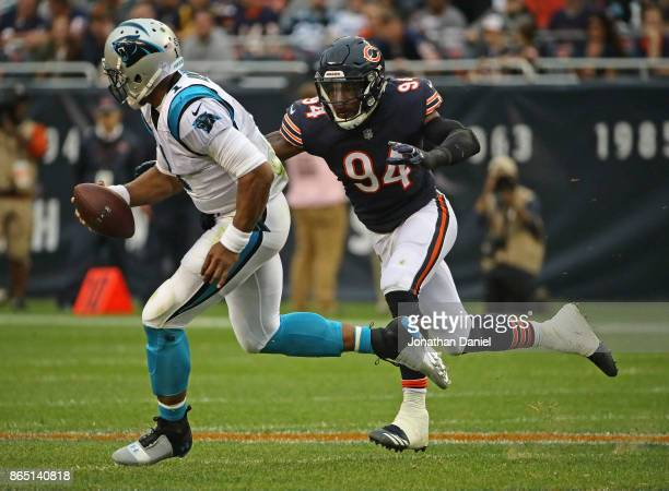 Leonard Floyd of the Chicago Bears chases Cam Newton of the Carolina Panthers at Soldier Field on October 22 2017 in Chicago Illinois The Bears...