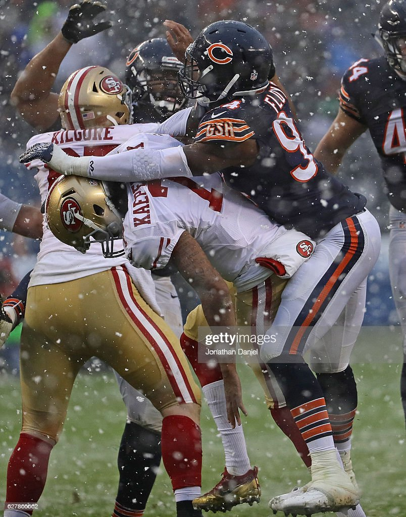 Leonard Floyd #94 of the Chicago Bears hits Colin Kaepernick #7 of the San Francisco 49ers after a pass at Soldier Field on December 4, 2016 in Chicago, Illinois. The Bears defeated the 49ers 26-6.