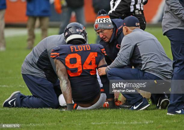 Leonard Floyd of the Chicago Bears is attended to by doctors on the field after suffering an apparent knee injury against the Detroit Lions at...