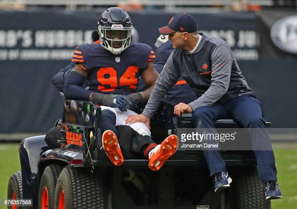 Leonard Floyd of the Chicago Bears is carted off of the field after suffering an apparent knee injury against the Detroit Lions at Soldier Field on...