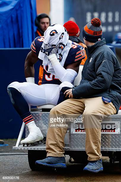 Leonard Floyd of the Chicago Bears is carted off of the field in the second quarter against the Washington Redskins at Soldier Field on December 24...