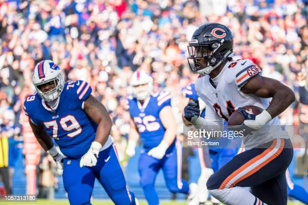 Leonard Floyd of the Chicago Bears runs an interception for a touchdown during the second quarter against the Buffalo Bills at New Era Field on...