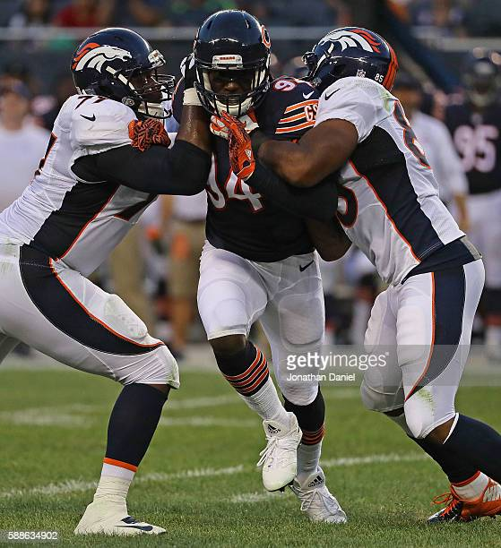 Leonard Floyd of the Chicago Bears rushes against Darrion Weems and Virgil Green of the Denver Broncos at Soldier Field on August 11 2016 in Chicago...