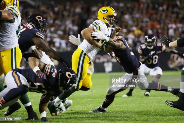Leonard Floyd of the Chicago Bears sacks Aaron Rodgers of the Green Bay Packers during the first quarter in the game at Soldier Field on September 05...