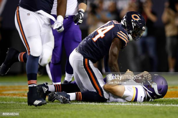 Leonard Floyd of the Chicago Bears sacks quarterback Sam Bradford of the Minnesota Vikings for a safety in the first quarter at Soldier Field on...