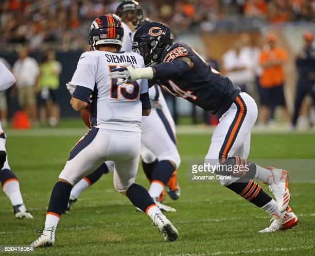Leonard Floyd of the Chicago Bears sacks Trevor Siemian of the Denver Broncos during a preseason game at Soldier Field on August 10 2017 in Chicago...