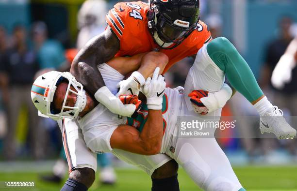 Leonard Floyd of the Chicago Bears tackles Danny Amendola of the Miami Dolphins during the game between the Miami Dolphins and the Chicago Bears at...