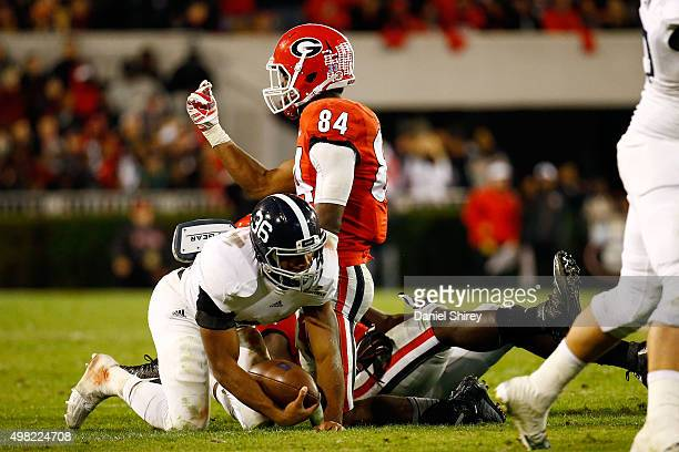 Leonard Floyd of the Georgia Bulldogs celebrates after tackling Matt Breida of the Georgia Southern Eagles for a loss during the second half at...