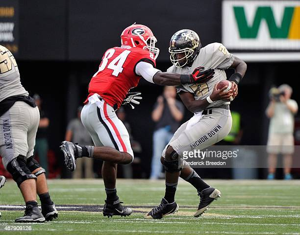 Leonard Floyd of the Georgia Bulldogs sacks quarterback Johnny McCrary of the Vanderbilt Commodores during the first half at Vanderbilt Stadium on...
