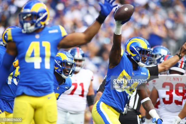 Leonard Floyd of the Los Angeles Rams celebrates recovering a fumble against the New York Giants at MetLife Stadium on October 17, 2021 in East...