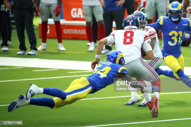 Leonard Floyd of the Los Angeles Rams tackles Daniel Jones of the New York Giants during the first half at SoFi Stadium on October 04, 2020 in...