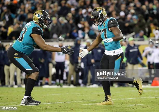 Leonard Fournette and Calais Campbell of the Jacksonville Jaguars celebrate after Fournette ran for a touchdown during the second half of their game...