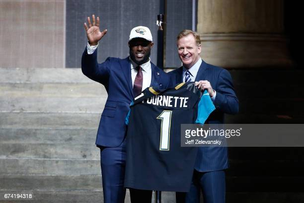 Leonard Fournette of LSU poses with Commissioner of the National Football League Roger Goodell after being picked overall by the Jacksonville Jaguars...