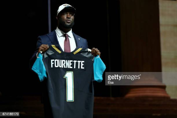Leonard Fournette of LSU reacts after being picked overall by the Jacksonville Jaguars during the first round of the 2017 NFL Draft at the...
