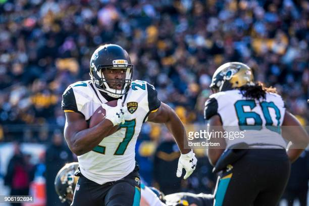 Leonard Fournette of the Jacksonville Jaguars carries the ball for a touchdown originally ruled out at the 1 yard line during the AFC Divisional...