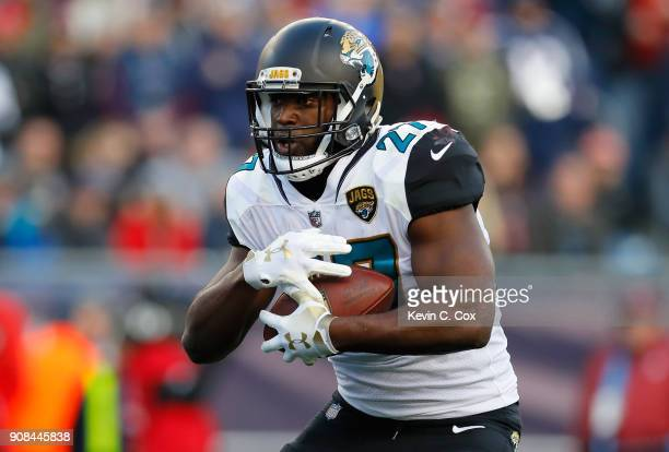 Leonard Fournette of the Jacksonville Jaguars carries the ball in the first half during the AFC Championship Game against the Jacksonville Jaguars at...
