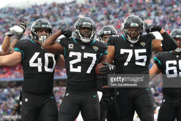 Leonard Fournette of the Jacksonville Jaguars celebrates after scoring a touchdown in the second quarter during NFL game action against the Buffalo...