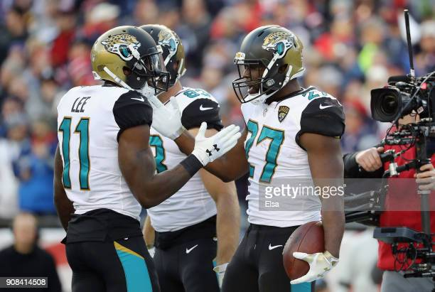 Leonard Fournette of the Jacksonville Jaguars celebrates with teammates after a touchdown in the second quarter during the AFC Championship Game...