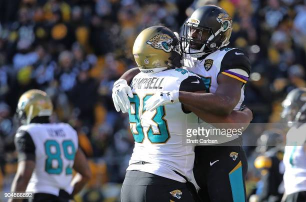 Leonard Fournette of the Jacksonville Jaguars celebrates with Calais Campbell after rushing for a 1 yard touchdown in the first quarter during the...