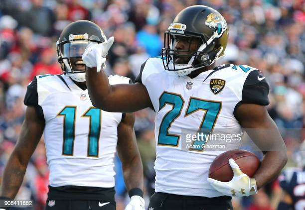 Leonard Fournette of the Jacksonville Jaguars celebrates with Marqise Lee after a touchdown in the second quarter during the AFC Championship Game...