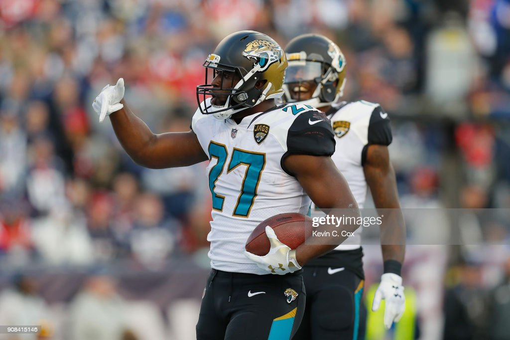 Leonard Fournette #27 of the Jacksonville Jaguars celebrates with Marqise Lee #11 after a touchdown in the second quarter during the AFC Championship Game against the New England Patriots at Gillette Stadium on January 21, 2018 in Foxborough, Massachusetts.