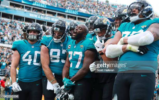 Leonard Fournette of the Jacksonville Jaguars celebrates with the Jacksonville Jaguars offense following a second half touchdown against the...