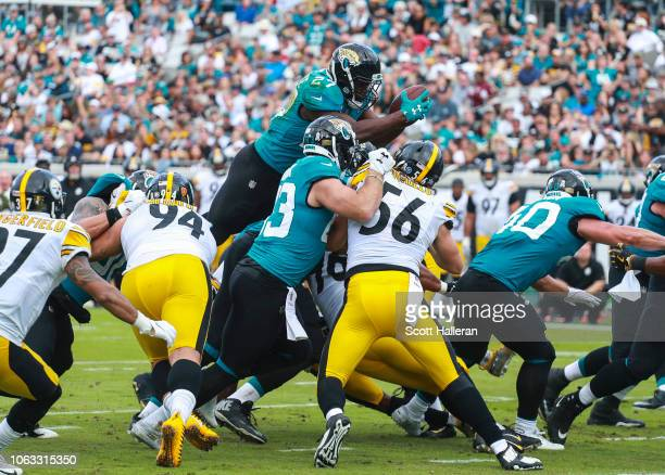Leonard Fournette of the Jacksonville Jaguars dives for a touchdown during the second half against the Pittsburgh Steelers at TIAA Bank Field on...