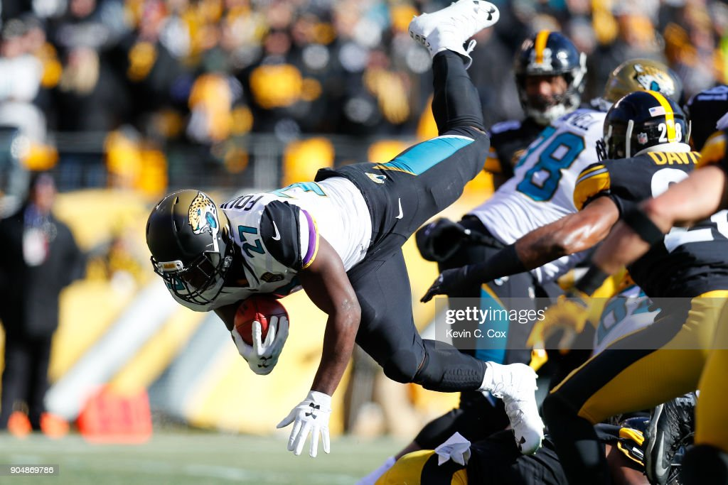 Leonard Fournette #27 of the Jacksonville Jaguars dives into the end zone for a touchdown against the Pittsburgh Steelers during the first half of the AFC Divisional Playoff game at Heinz Field on January 14, 2018 in Pittsburgh, Pennsylvania.
