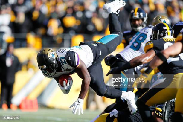 Leonard Fournette of the Jacksonville Jaguars dives into the end zone for a touchdown against the Pittsburgh Steelers during the first half of the...