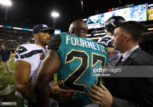 Leonard Fournette of the Jacksonville Jaguars greets Russell Wilson of the Seattle Seahawks after the Jaguars defeated the Seahawks 3024 at EverBank...
