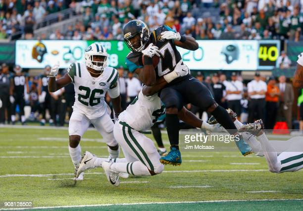 Leonard Fournette of the Jacksonville Jaguars in action against Marcus Maye and Jordan Jenkins of the New York Jets on October 1 2017 at MetLife...