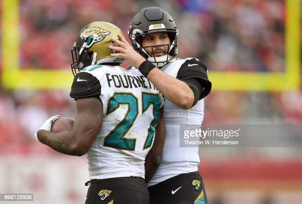 Leonard Fournette of the Jacksonville Jaguars is congratulated by Blake Bortles after Fournette scored on a 1yard touchdown run against the San...