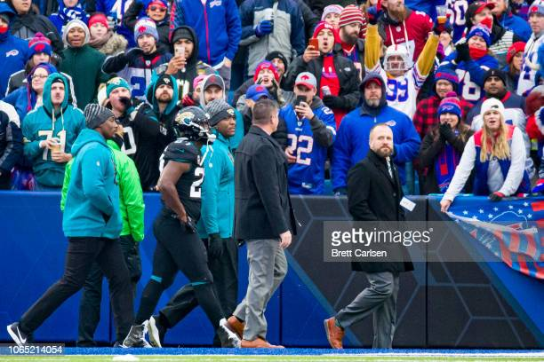 Leonard Fournette of the Jacksonville Jaguars is escorted off the field following an ejection during the third quarter against the Buffalo Bills at...