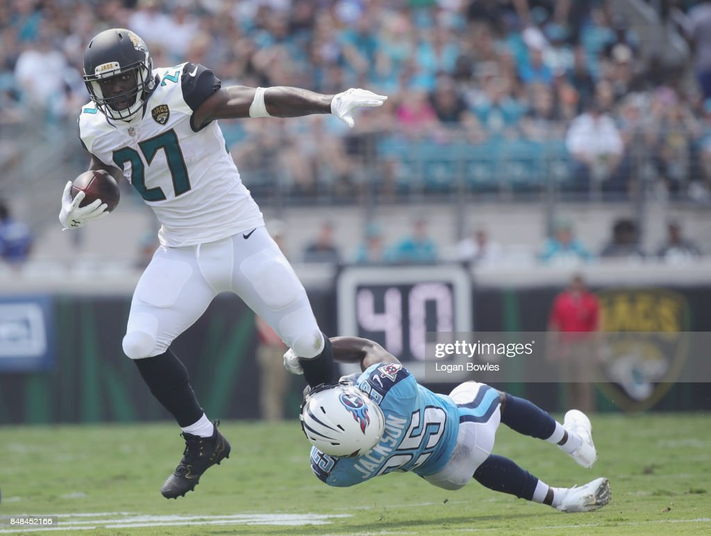 Leonard Fournette #27 of the Jacksonville Jaguars is tackled by Adoree' Jackson #25 of the Tennessee Titans during the first half of their game at EverBank Field on September 17, 2017 in Jacksonville, Florida.