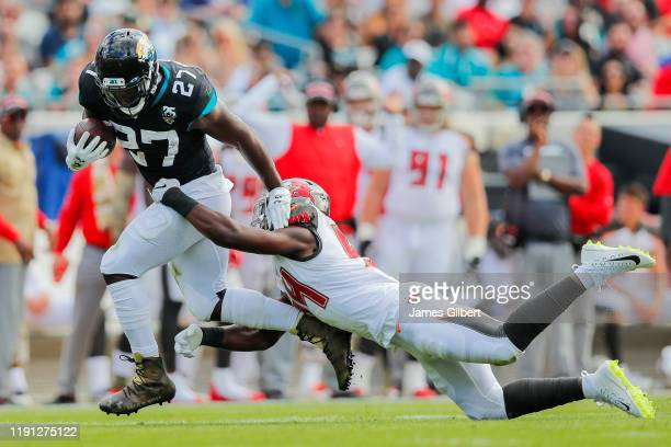 Leonard Fournette of the Jacksonville Jaguars is tackled by Lavonte David of the Tampa Bay Buccaneers during the second quarter of a game at TIAA...