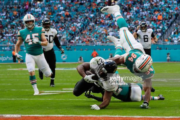 Leonard Fournette of the Jacksonville Jaguars is tackled by Robert Quinn of the Miami Dolphins in the first quarter at Hard Rock Stadium on December...
