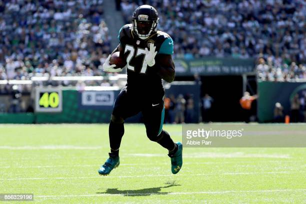 Leonard Fournette of the Jacksonville Jaguars runs for a 10 yard touchdown against the New York Jets in the first quarter during their game at...