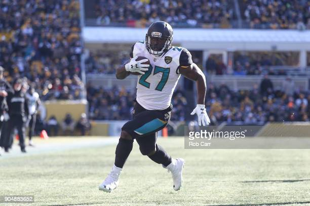 Leonard Fournette of the Jacksonville Jaguars runs for a touchdown against the Pittsburgh Steelers during the first half of the AFC Divisional...