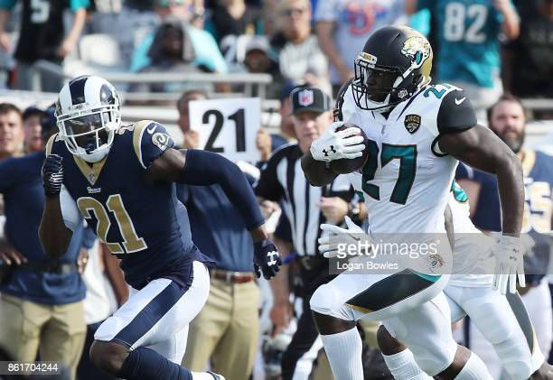 Leonard Fournette of the Jacksonville Jaguars runs past Kayvon Webster of the Los Angeles Rams for a 75yard touchdown in the first half of their game...
