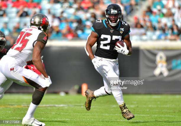 Leonard Fournette of the Jacksonville Jaguars runs the ball in the first quarter of a football game against the Tampa Bay Buccaneers at TIAA Bank...
