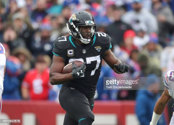 Leonard Fournette of the Jacksonville Jaguars runs with the ball in the second quarter during NFL game action against the Buffalo Bills at New Era...